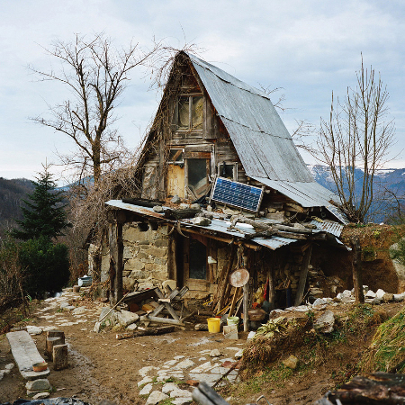 old shack with one solar panel